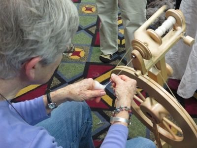 Maggie demonstrating worsted spinning
