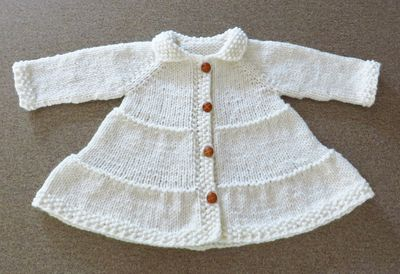 Tiered coat with buttons cropped