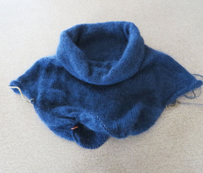 This sweater is actually inside-out. When it's done you're supposed to wear it with the reverse stockinette showing.