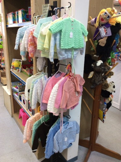 Beautiful baby sweaters, locally hand knit and crocheted.