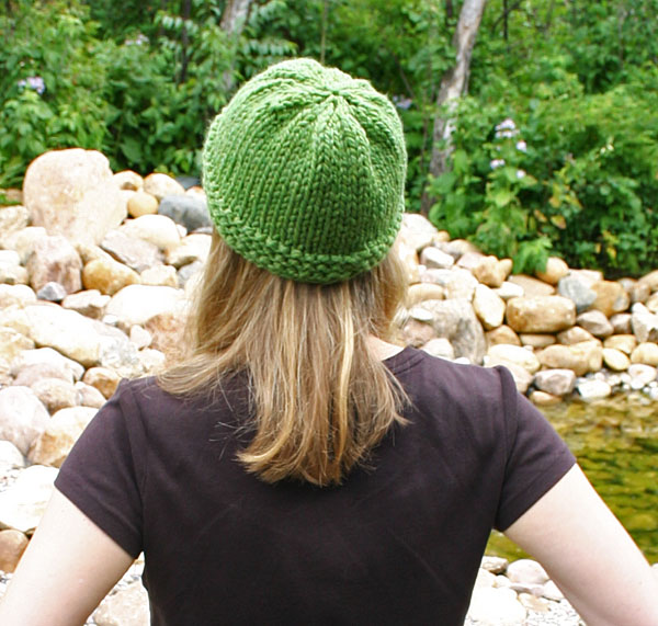 Green hat back view